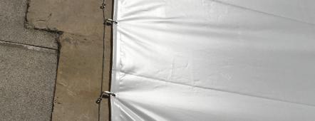 bâche acoustique pour grandes surfaces - Fixation en périphérie (oeillets)